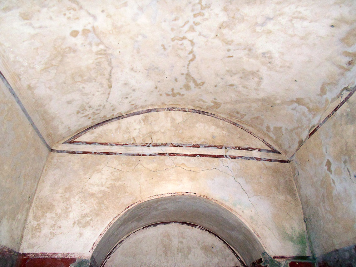 The ceiling and niche opposite the tapering shaft to daylight